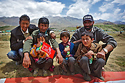 Ladakhi Muslim family of Drass watching the polo match organized by The Lalit Suri Hospitality group.<br /> <br /> Drass moves beyond the scars of the Kargil war to cheer the Polo match conceptualized by The Lalit Suri Hospitality Group who landed at the high turfs, for a friendly game to prompte tourism in the J&K region. The third season of The Lalit Suri Polo 2011 held at the Vishwanathan Stadium, at an altitude of 3280 meters and the second coldest habitat on earth, witnessed an enlivening & festive atmosphere. The match was cheered by thousands of locals and was accompanied by traditional Surna - a wind instrument and Daman - traditional percussion instument, without which no polo match is complete in Drass