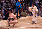 Yokuzuna ranked Mongolian Hakuho (Mönkhbatyn Davaajargal; left) after winning a bout against Ozeki ranked fellow-Mongolian Harumafuji (Davaanyamyn Byambadorj, right) in the controversial Nagoya summer Grand Sumo Tournament held on the 14th and second final day.