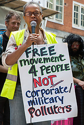 London, UK. 29 July, 2019. Sara Callaway of Women of Colour in the Global Women's Strike addresses activists from Reclaim the Power, All African Women's Group, Docs Not Cops, Lesbians and Gays Support the Migrants and other groups during a protest outside the Home Office to demand an end to the Government's 'hostile environment' policies.