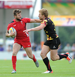 Harley Thomson of Wales is chased down by Hendrick Brouwers of Belgium - Photo mandatory by-line: Dougie Allward/JMP - Mobile: 07966 386802 - 11/07/2015 - SPORT - Rugby - Exeter - Sandy Park - European Grand Prix 7s