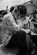 A distraught resident in inconsoable after learning of the death of family members. Such was the devastation and collapse of her dwelling she is still unable to detect the location of her former apartment.