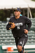 New York Yankees Alex Rodriguez following fielding practice before appearing in the first game since hip surgery with the minor league Charleston RiverDogs at Joseph P. Riley Jr. Stadium July 2, 2013 in Charleston, South Carolina.