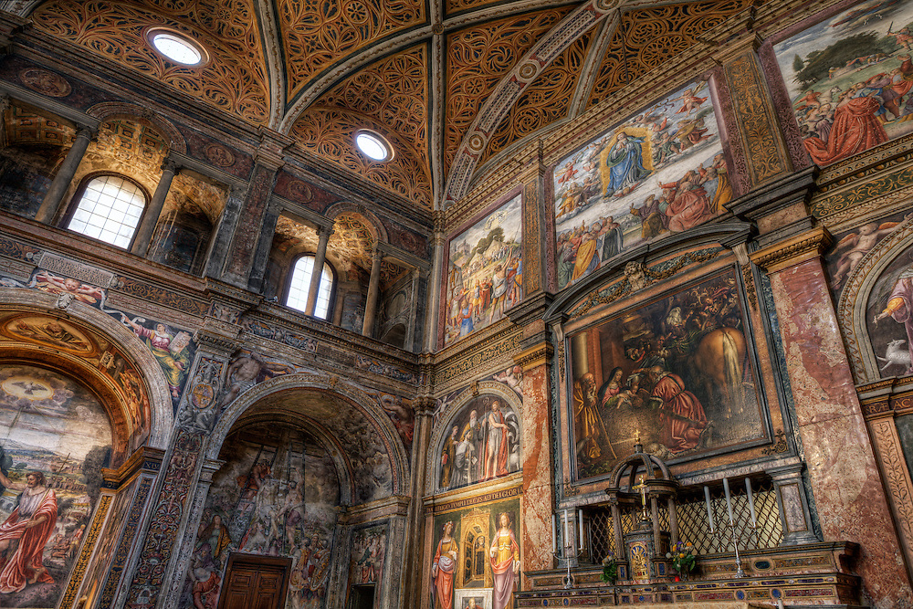 The Chiesa di San Maurizio al Monastero Maggiore was built in 1503 by Gian Giacomo Dolcebuono. It was finished fifteen years later by Cristoforo Solari, divided into two parts: one for the faithful and one for the nuns. Until 1794 the nuns were strongly forbidden to cross the dividing wall. The dividing wall has frescoes depicting the Life of San Maurizio by Bernardino Luini, a student of Leonardo da Vinci, which flank an altarpiece with an Adoration of the Magi by Antonio Campi. The convent hall (or hall of the nuns) is also completely painted. The partition wall, a work by Bernardino Luini, presents images of Saint Catherine, Saint Agatha, the Marriage at Cana, the Carrying of the Cross of Christ on the Cross and Christ died. On the vault of the hall is depicted a starry sky, with God, the Evangelists, and angels. Also in the convent hall there is an organ of 1554 by Giovan Giacomo Antegnati entirely by mechanical transmission, consisting of a keyboard of 50 notes and a pedal 20, constantly united to the keyboard. The organ's case was decorated by Francesco and Girolamo de' Medici da Seregno.