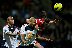 BOLTON, ENGLAND - Saturday, January 21, 2011: Liverpool's Andy Carroll in action against Bolton Wanderers' David Ngog during the Premiership match at the Reebok Stadium. (Pic by David Rawcliffe/Propaganda)