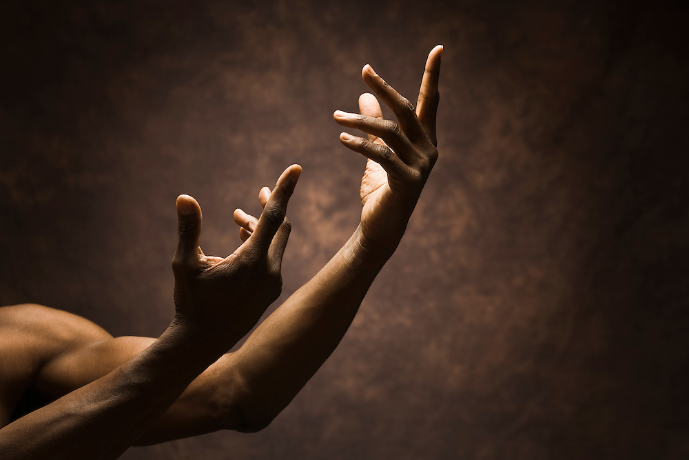 Portraits of a pair of dark complexioned hands and arms in various positions, and gestures / expressions.