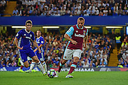 West Ham United midfielder Gokhan Tore (17) clears from Chelsea midfielder Oscar (8) during the Premier League match between Chelsea and West Ham United at Stamford Bridge, London, England on 15 August 2016. Photo by Jon Bromley.