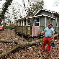 Thomas Wells | BUY AT PHOTOS.DJOURNAL.COM<br /> Chris Childs explanis how to cut up a tree after it was been removed to make cleanup easier and faster.