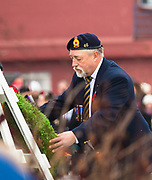 Revelstoke Legion president Ed Koski lays a wreath during the Remembrance Day ceremony at the cenotaph on Nov. 11, 2017.
