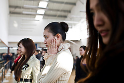 "Participants of ""Miss. International"" beauty contest receive training on how to make beautiful expression using mirror in Beijing, China, Nov. 4, 2009."