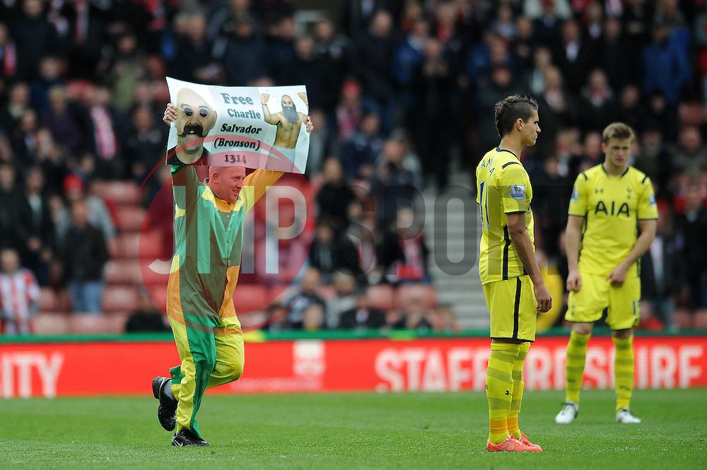 A fan invades the pitch before the second half starts  - Photo mandatory by-line: Dougie Allward/JMP - Mobile: 07966 386802 - 09/05/2015 - SPORT - Football - Stoke - Britannia Stadium<br />  - Stoke v Tottenham Hotspur - Barclays Premier League