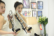 TAIYUAN, CHINA - (CHINA OUT) <br /> <br /> Diamond High-heeled Sandals <br /> A pair of high-heeled sandals, which is studded with diamonds, worth 128,000 Yuan (20,508 USD) is seen at 2013 EURO WALK Spring/Summer New Products Exhibition in Taiyuan, Shanxi Province of China. diamond, high-heel, sandals, luxury, business, odd<br /> ©ChinaFoto/Exclusivepix