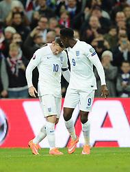 Danny Welbeck of England (Arsenal) celebrates with Wayne Rooney of England (Manchester United)  - Photo mandatory by-line: Joe Meredith/JMP - Mobile: 07966 386802 - 15/11/2014 - SPORT - Football - London - Wembley - England v Slovenia - EURO 2016 Qualifier