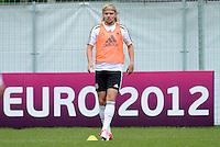 FUSSBALL INTERNATIONAL  EURO 2012   07.06.2012  Training der Deutschen Nationalmannschaft in Danzig Marcel Schmelzer (Deutschland)   vor einer Werbebande UEFA EURO 2012