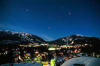 Star trails over Whistler and Blackcomb Mountains, Whistler winter night.