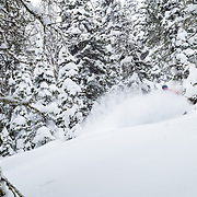 Jim Ryan skis the motherload of cold smoke powder during a major winter storm in the backcountry of the Tetons.