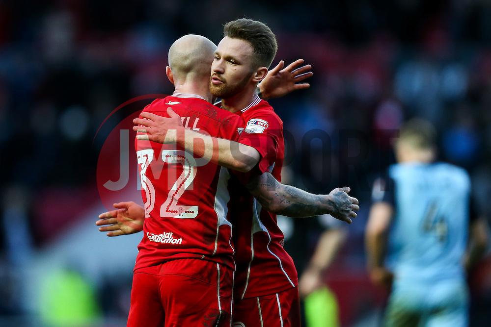 New signings David Cotterill of Bristol City and Matty Taylor hug aftera 1-0 win - Rogan Thomson/JMP - 04/02/2017 - FOOTBALL - Ashton Gate Stadium - Bristol, England - Bristol City v Rotherham United - Sky Bet Championship.
