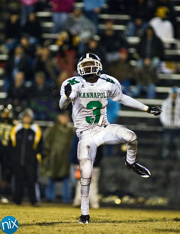 Kannapolis' Tevin Jones celebrates after intercepting a Concord pass Friday night at Concord High School. The Wonders won 28-21 to reclaim the bell in the 80th installment of the cross town rivalry known as the Battle of the Bell. (Photo by James Nix)