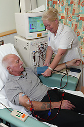Support Nurse on Dialysis Unit checking renal outpatients blood pressure,