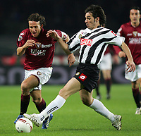 "Gianluca Comotto (Torino), Gaetano D'Agostino (Udinese)<br /> Italian ""Serie A"" 2006-07<br /> 27 Jan 2007 (Match Day 21)<br /> Torino-Udinese (2-3)<br /> ""Olimpico""-Stadium-Torino-Italy<br /> Photographer: Luca Pagliaricci INSIDE"