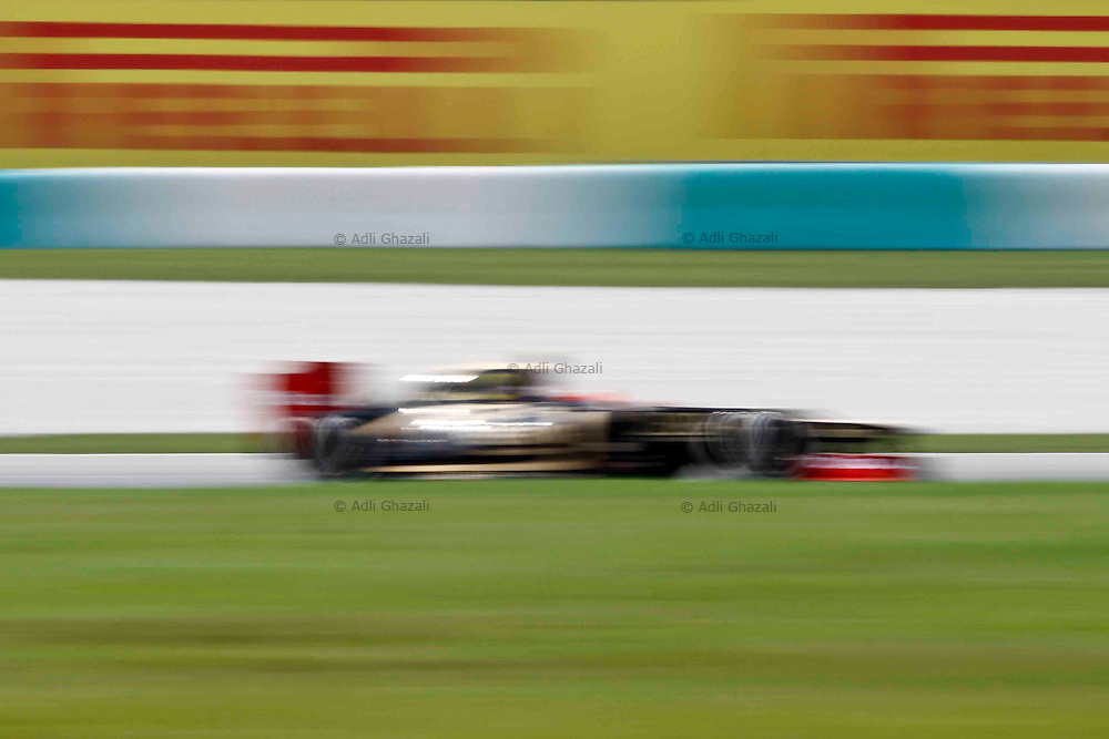 Lotus F1 Team on practice session during 2012 Malaysia Grand Prix at Sepang circuit, outside Kuala Lumpur, Malaysia 23 March 2012. The Formula One Grand Prix of Malaysia will take place on 25 March 2012.