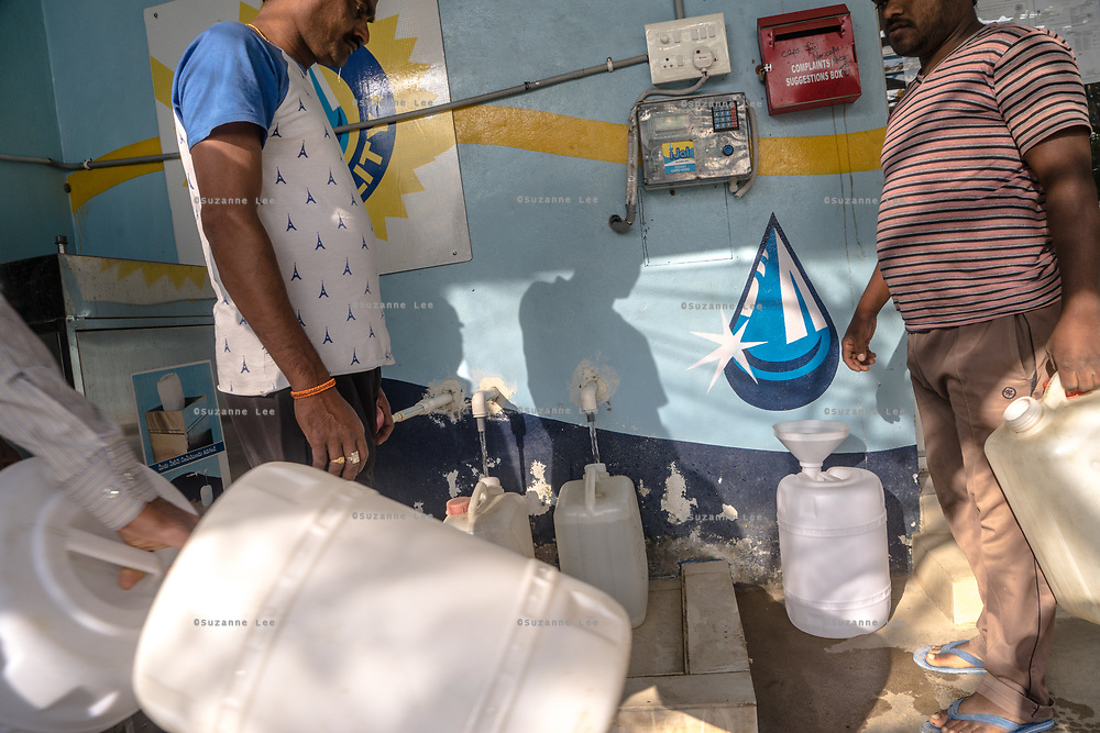 Customers fill water cans at a Safe Water Network iJal station in Rangsaipet, in Waragal, Telangana, Indiia, on Sunday, February 10, 2019. Photographer: Suzanne Lee for Safe Water Network