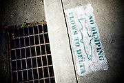 Warning on storm drains in Stockton, Calif., September 22, 2009.