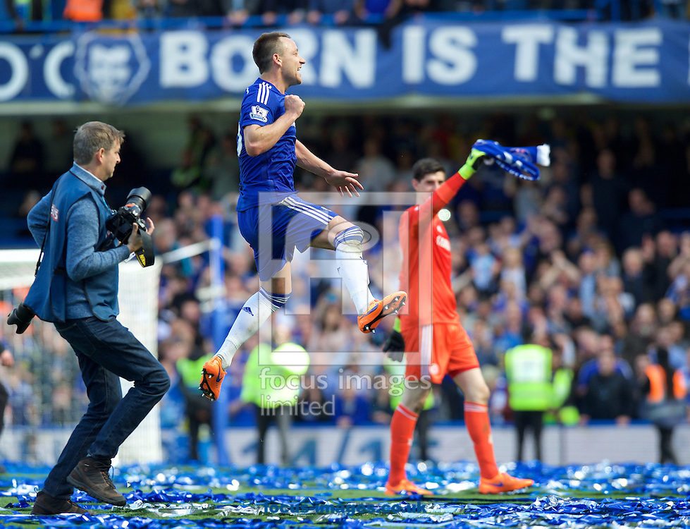 John Terry of Chelsea celebrates winning the premiership title after their 1-0 win over Crystal Palace in the Barclays Premier League match at Stamford Bridge, London<br /> Picture by Alan Stanford/Focus Images Ltd +44 7915 056117<br /> 03/05/2015