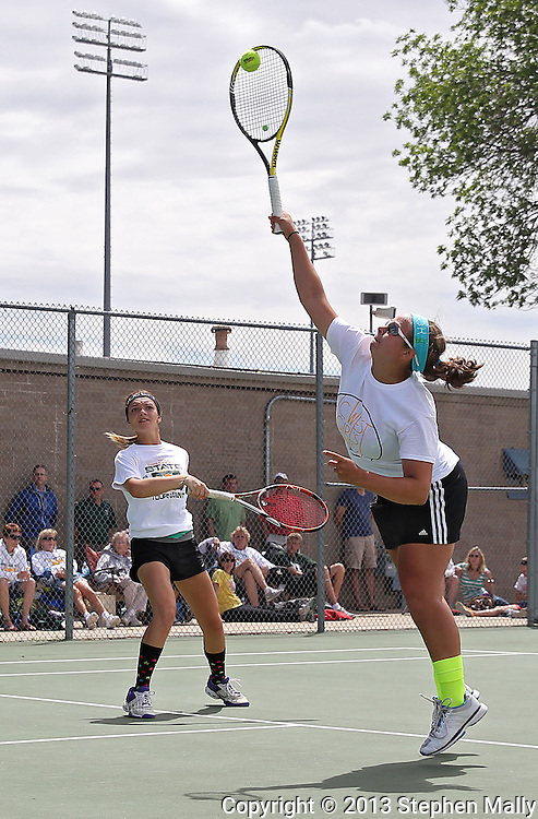 Iowa City West's Elena Wilson (right) returns the ball as Addy Riley looks on during a doubles match in the Class 2A state team tennis tournament at Veterans Memorial Tennis Center in Cedar Rapids on Saturday, June 1, 2013.