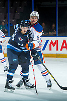 PENTICTON, CANADA - SEPTEMBER 9: Kristian Reichel #90 of Winnipeg Jets is checked by Liam Schioler #85 of Edmonton Oilers during third period on September 9, 2017 at the South Okanagan Event Centre in Penticton, British Columbia, Canada.  (Photo by Marissa Baecker/Shoot the Breeze)  *** Local Caption ***
