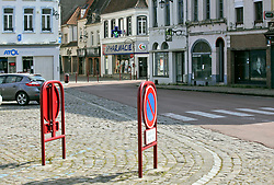 02 April 2020. Hesdin, Pas de Calais, France. <br /> Coronavirus - COVID-19 in Northern France.<br /> <br /> The almost deserted streets of Hesdin despite an easing of restrictions on local markets. For the first time since government restrictions came into force, the main market in Hesdin has been permitted to re-open. The historical town has hosted a usually vibrant and bustling market since the middle ages. With stall holders limited and many suffering huge financial losses, those selling food today were happy to be back to work despite the ongoing risks posed by coronavirus.<br /> <br /> Shoppers, many wearing masks were mostly maintaining their social distancing with people happy to be out and able to meet and talk with other people. A lot of shoppers were elderly people who have been trapped in their homes for weeks. One shopper complained of 'la misère,' - the misery of this virus and being stuck in her home. <br /> <br /> Anyone leaving their home must carry with them an 'attestation,' in a effect a self administered permit to allow them out of the house. If stopped by the police, one must produce a valid permit along with identification papers. Failure to do so is punishable with heavy fines. Movement in France has been heavily restricted by the government and today's market re-opening was a brief return to normalcy for many able to escape the confines of their homes.<br /> <br /> Photo©; Charlie Varley/varleypix.com