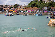 Teenagers swimming in the Harbour, Folkestone, Kent.