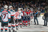 KELOWNA, CANADA - MARCH 28: The Tri-City Americans congratulate the Kelowna Rockets on the series win after game 5 of the first round of WHL playoffs on March 28, 2014 at Prospera Place in Kelowna, British Columbia, Canada.   (Photo by Marissa Baecker/Shoot the Breeze)  *** Local Caption ***