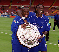 Jimmy Floyd Hasselbaink and Mario Melchiot (Chelsea) celebrate with the Charity Shield. Chelsea v Manchester United. FA Charity Shield. Wembley 13/8/00. Credit: Colorsport.