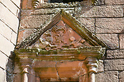 "In the courtyard of Caerlaverock Castle, walk through Nithsdale Lodging, a remarkable residence built in 1635, ""the most ambitious early classical domestic architecture in Scotland."" The formidable red sandstone walls of Caerlaverock Castle have a triangular shape, unique in Britain. First built in 1295 to to control trade, its wide moat, twin-towered gatehouse and lofty battlements give Caerlaverock a fairtale appearance, the epitome of a medieval stronghold. Caerlaverock is near Dumfries, on the edge of Caerlaverock National Nature Reserve, in southwest Scotland, United Kingdom, Europe. This stronghold defended the Maxwell family from the 1200s-1640, then was abandoned. It was besieged by the English during the Wars of Scottish Independence, and underwent several partial demolitions and reconstructions from the 1300s-1400s."