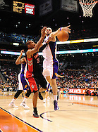 Jan. 24, 2012; Phoenix, AZ, USA; Toronto Raptors guard Leandro Barbosa (20) is guarded by Phoenix Suns forward Marcin Gortat (4) during the first half at the US Airways Center. Mandatory Credit: Jennifer Stewart-US PRESSWIRE.