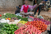 A slow shutter blur photo of a vegetable vendor selling vegetables in New Delhi, India.