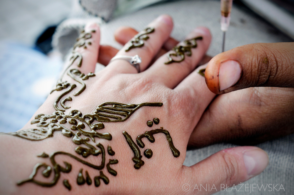 Morocco, Marrakesh. Making henna in Djamaa el-Fna Square.