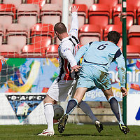 Dunfermline v St Johnstone....11.04.09<br /> Graham Gartland pulls Andy Kirk down for a penalty<br /> Picture by Graeme Hart.<br /> Copyright Perthshire Picture Agency<br /> Tel: 01738 623350  Mobile: 07990 594431
