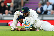 Wicket - Jasprit Bumrah of India takes the catch to dismiss Moeen Ali of England and is congratulated by Rishabh Pant of India during the first day of the 4th SpecSavers International Test Match 2018 match between England and India at the Ageas Bowl, Southampton, United Kingdom on 30 August 2018.