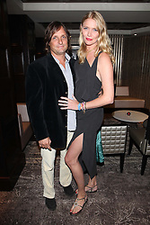 JODIE KIDD and ANDREA VIANINI at a party to celebrate the launch of the Hippodrome Casino, Leicester Square, London on 12th July 2012.