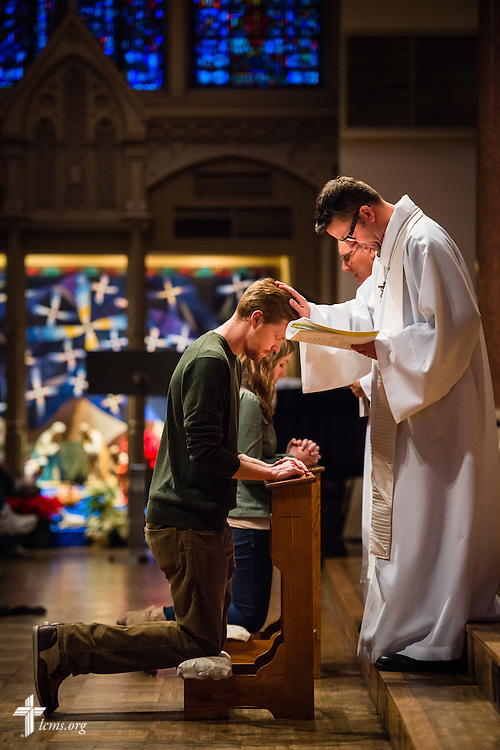 The Rev. Eric Andrae (front) absolves a participant in Saint Francis Xavier College Church during the 2015 TABOO National LCMS Campus Ministry Conference on Tuesday, Jan. 6, 2015, at Saint Louis University in St. Louis. LCMS Communications/Erik M. Lunsford
