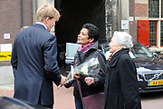 Prins Willem-Alexander bij de 70e herdenking bij van de slag in de Javazee in de Kloosterkerk , Den Haag.<br /> <br /> Prince Willem-Alexander at the 70th commemoration of the battle in the Java Sea in the Monastery Church, The Hague.<br /> <br /> Op de foto/ On the photo:  Prins Willem-Alexander krijgt een bloemetje , Koningin Beatrix zou aanvankelijk bij de plechtigheid aanwezig zijn, maar gaf prioriteit aan de aandacht voor prins Friso. <br /> <br /> Prince Willem-Alexander gets a flower, Queen Beatrix was initially present at the ceremony, but gave priority to the attention of Prince Friso.