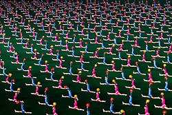 © Licensed to London News Pictures. 10/08/2011. Pyongyang, North Korea. Thousands of school children from Pyongyang perform synchronised gymnastics with coloured balls during the Arirang Mass Games.  The 100,000 performers train for up to three years before being ready to perform at the event which takes place nightly for around two months in summer each year. Photo credit : James Gourley/LNP/