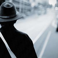 Man wearing hat standing in street