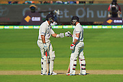 Ross Taylor of the New Zealand Black Caps celebrates his 150th run with Brendon McCullum (*c) of the New Zealand Black Caps during Day 3 on the 15th of November 2015. The New Zealand Black Caps tour of Australia, 2nd test at the WACA ground in Perth, 13 - 17th of November 2015.   Photo: Daniel Carson / www.photosport.nz