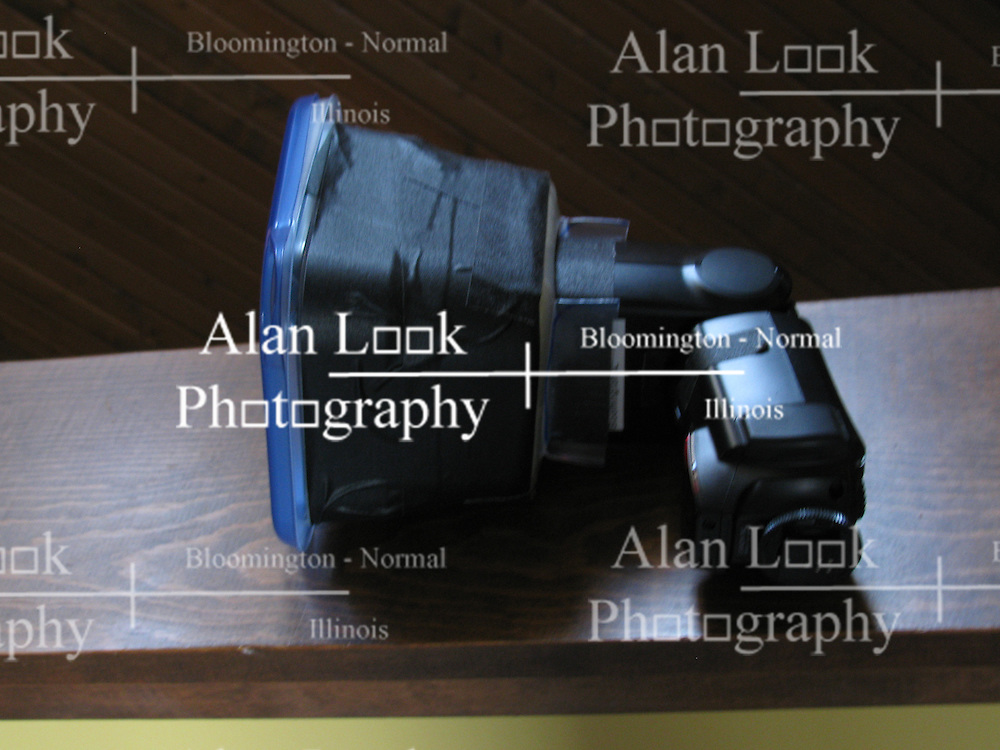 18 November 2011:   A Flash Extender that is fully enclosed and uses a fresnel lens to amplify the light as it passes.