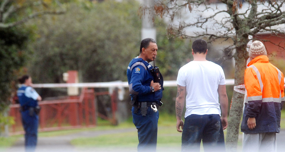 Police at the scene of a house on River Road were two people were shot and are now in a serious condition in Waikato hospital, Kawerau, New Zealand, Friday, September 13, 2013.  Credit SNPA / Lani Hepi