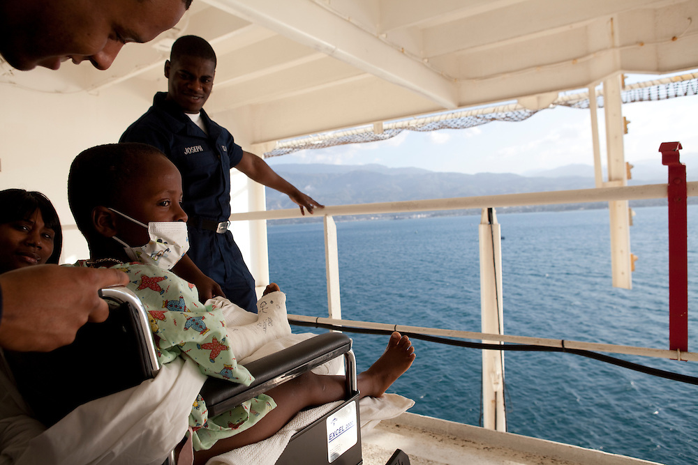 Doctors take a six year old Haitian boy who suffered a broken left leg during the recent earthquake out on the deck of the USNS Comfort, a U.S. Naval hospital ship, on January 21, 2010 in Port-au-Prince, Haiti. The Comfort deployed from Baltimore with 550 medical personnel on board to treat victims of Haiti's recent earthquake, and arrived on January 20.