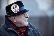 Croatian old man wearing hat with sign - EU, no thank you.