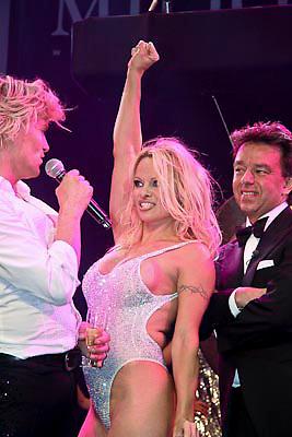 NLD/Amsterdam/20081211 - Miljonairfair 2008, opening van de beurs door Hans Klok en Pamela Anderson